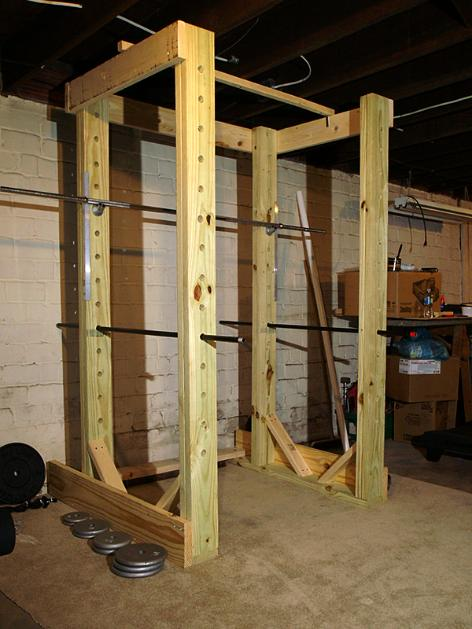 Homemade power rack made out of wood and pipe Build my home