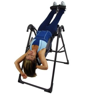 If You Have The Space In Your Gym, The Easiest Way To Hang Upside Down Is  To Buy An Inversion Table: